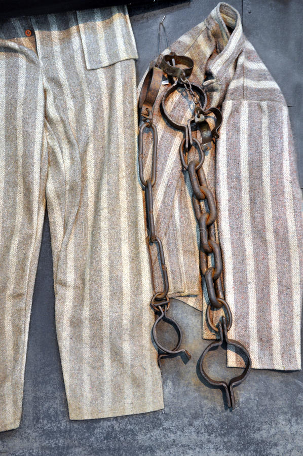 Chain, fetter and prisoner clothes in a prison. Chain, fetter and prisoner clothes in a Romanian prison royalty free stock images