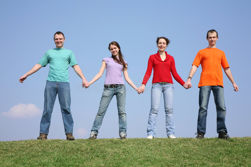 Chain friends on meadow stock image