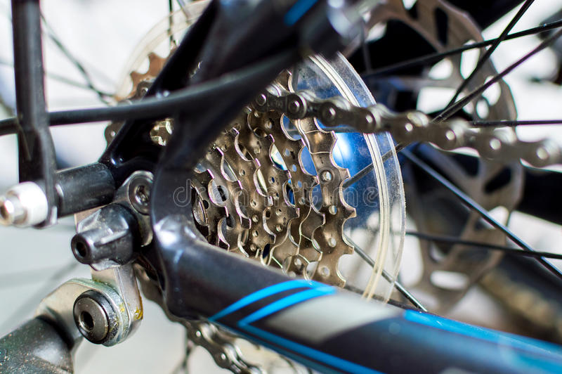 Chain and gear system of bicycle. Detail of rear bicycle wheel with chain and gear system stock photos