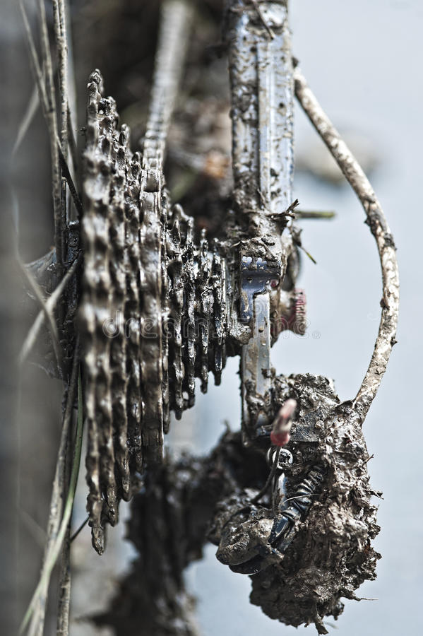 Chain and gears full with mud stock photography