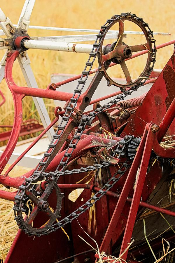 The chain and gears on an old swather royalty free stock image