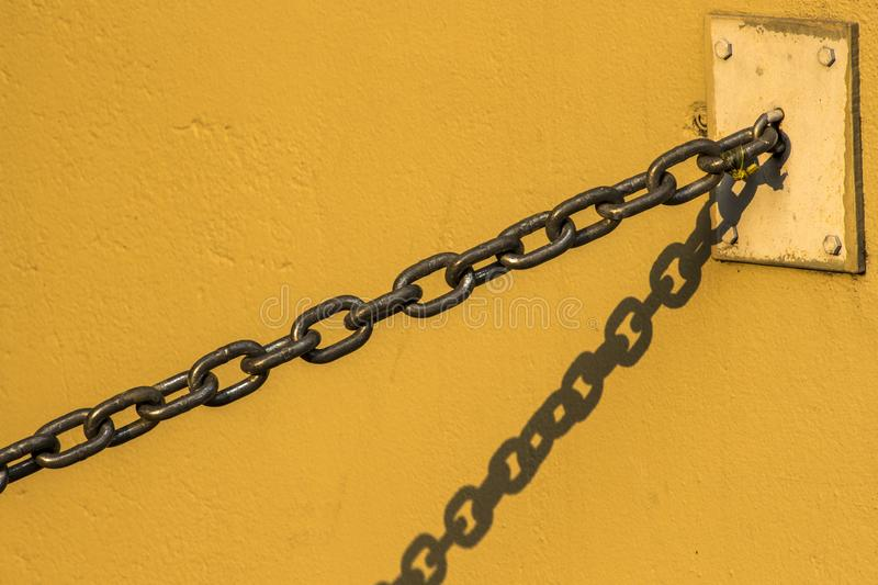 Chain hanging on the wall royalty free stock image