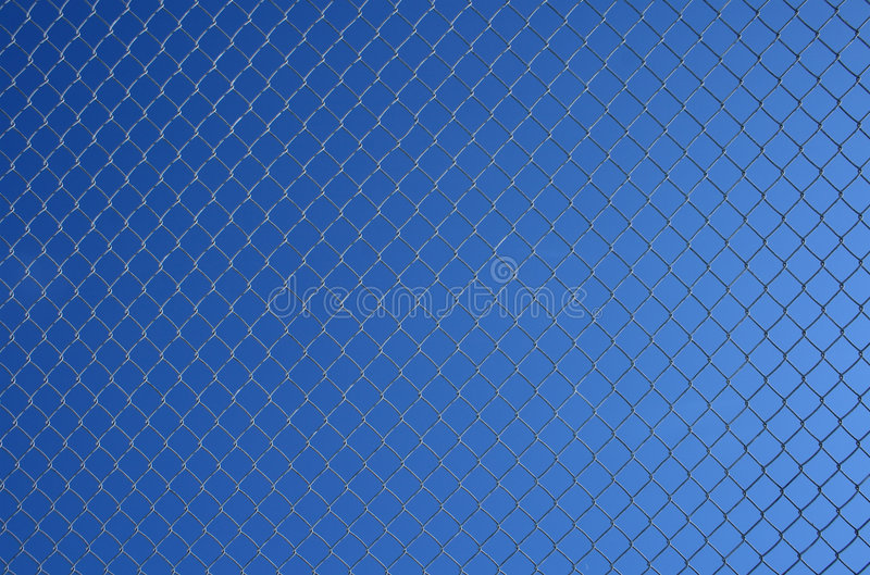 Chain link fence against sky stock photo