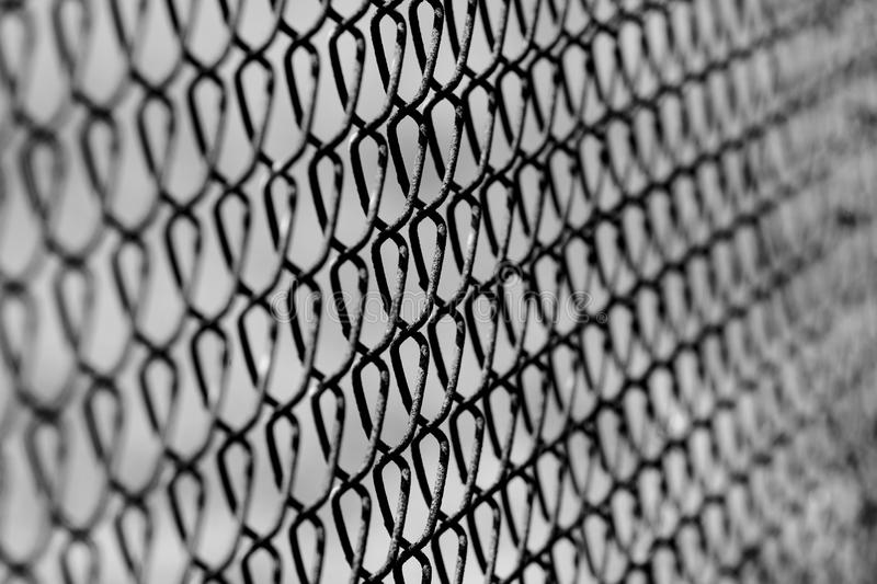 Chain link fence background. Selective focus chain link fence background royalty free stock photos