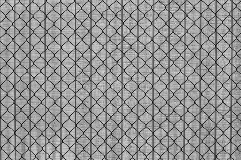 Chain link fence and wood building wall royalty free stock photo