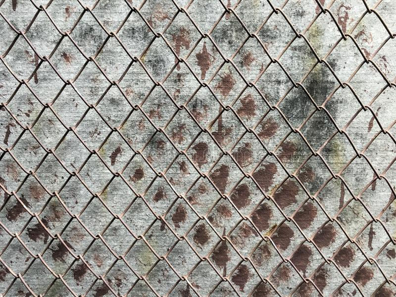 Chain link on old wall stock images