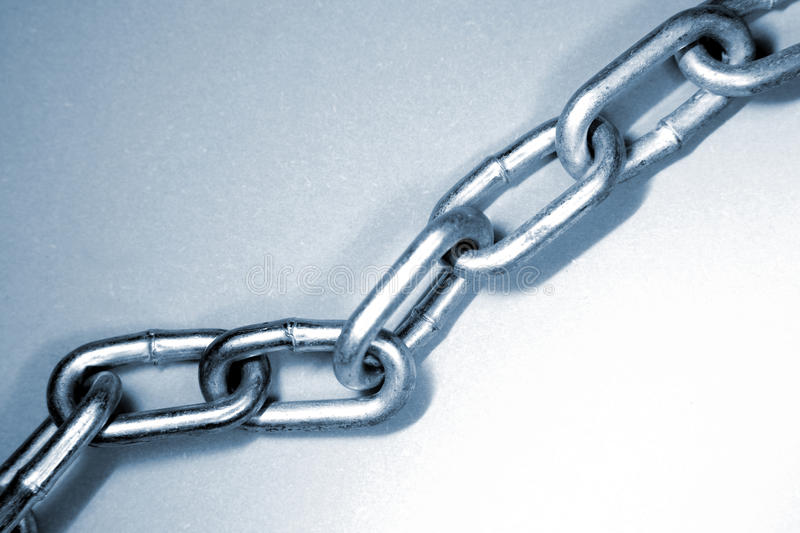 Chain links. Steel chain links, blue tone royalty free stock photo