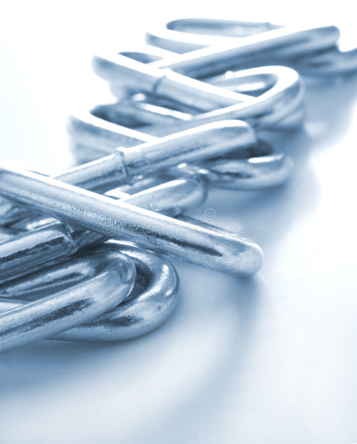 Chain Links. A closeup view of steel chain links in blue tone stock photo