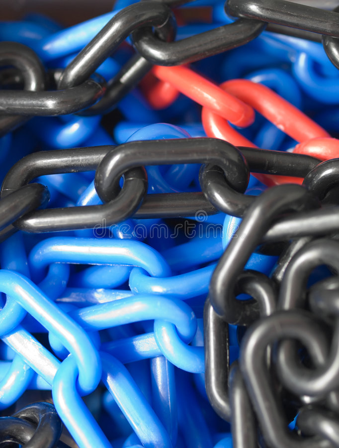 Chain Links. Colorful plastic chain links bundled up after use stock photography
