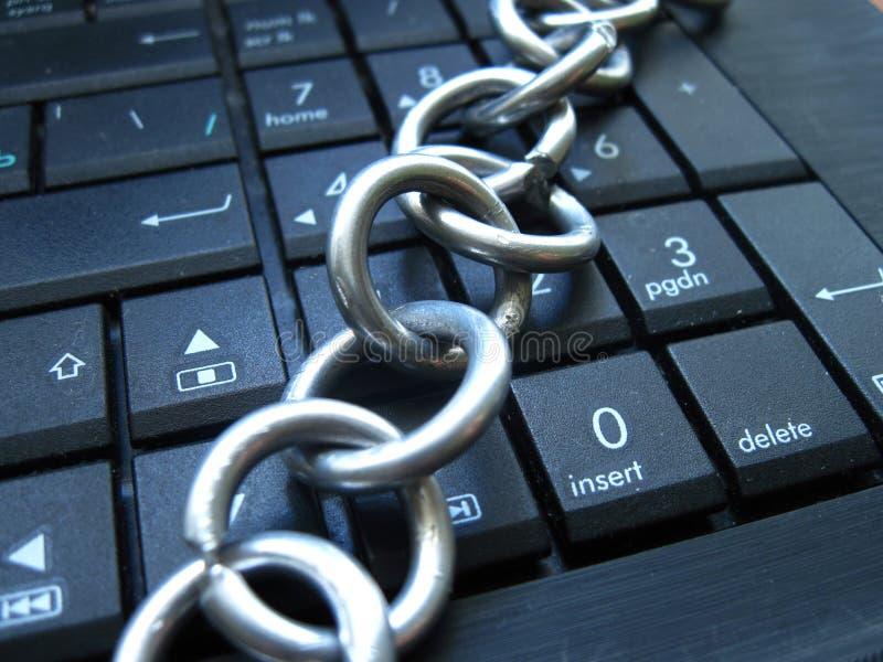 Chain and lock on laptop keyboard. Computer ban, internet ban. Addiction. Anti virus royalty free stock photography