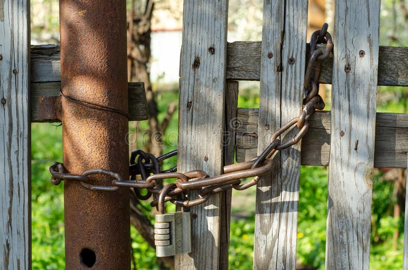 Chain lock on a wooden fence stock image