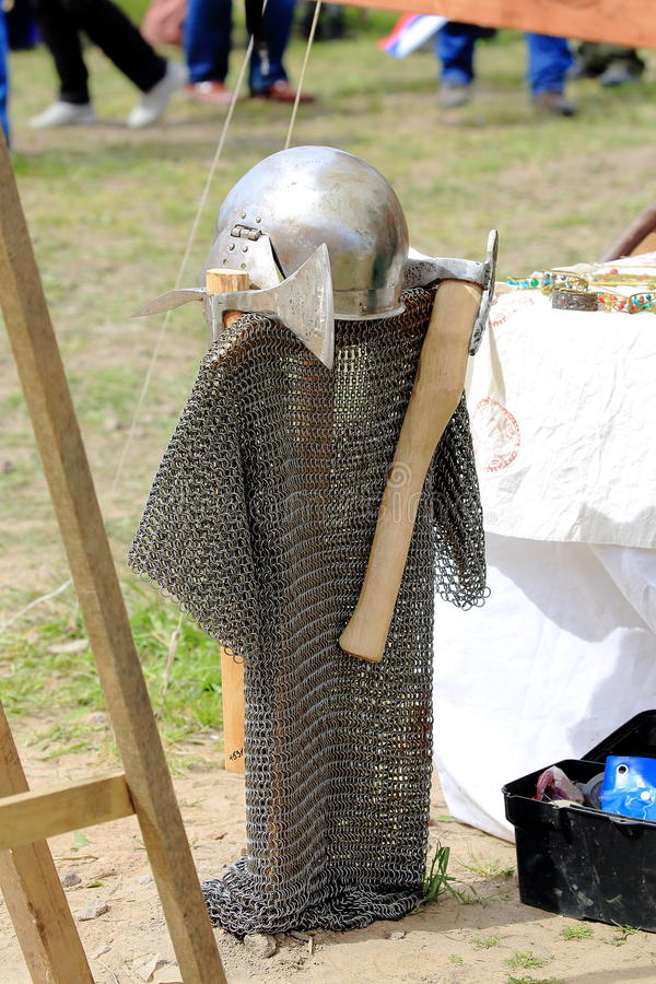 Chain mail, battle helmet and axes. Back view. Festival `Legends of the Norwegian Vikings`. Hare Island. Saint-Petersburg, Russia royalty free stock images