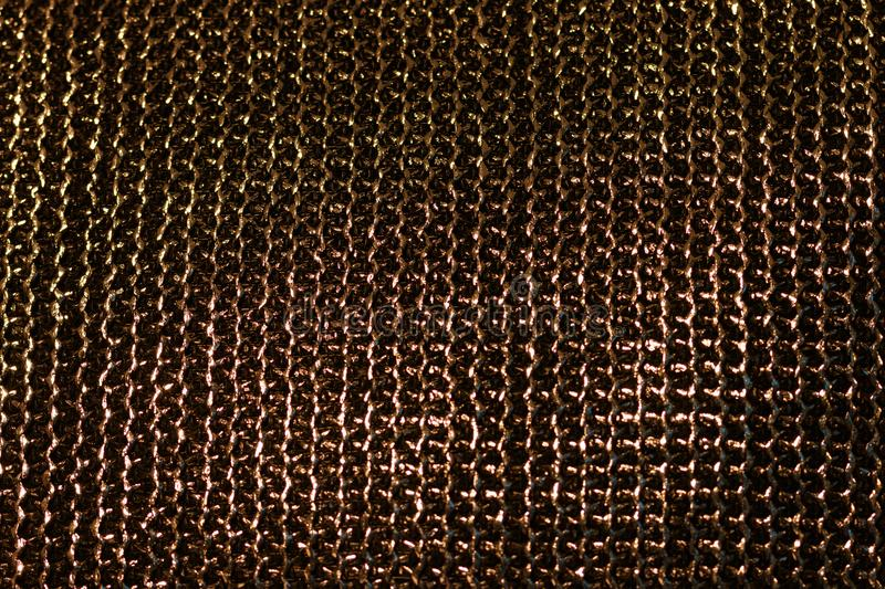 Chain mail texture. Texture of the chain mail. Gold weaving of chain mail stock photo