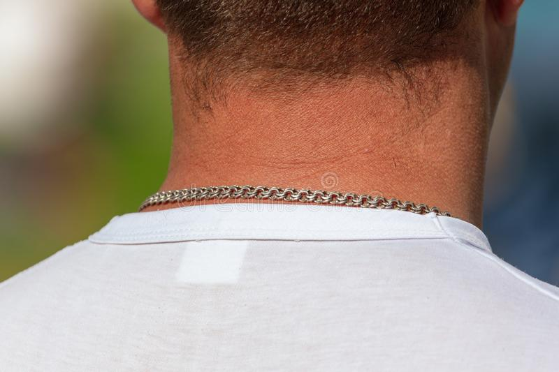 Chain on the neck of a man royalty free stock photography