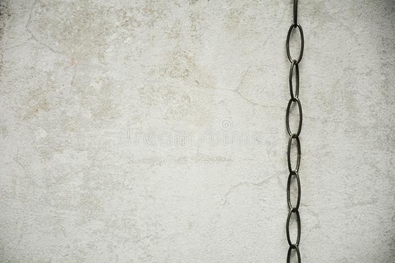 Chain with old concrete wall royalty free stock image