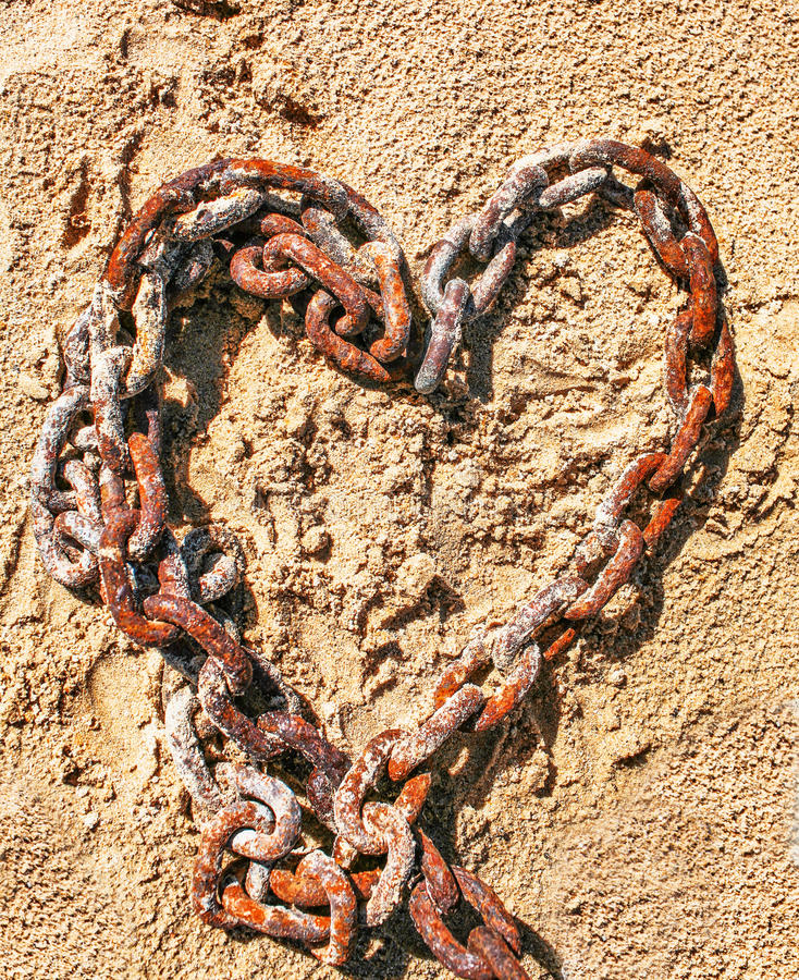 Chain In The Shape Of A Heart On The Sand Stock Photos