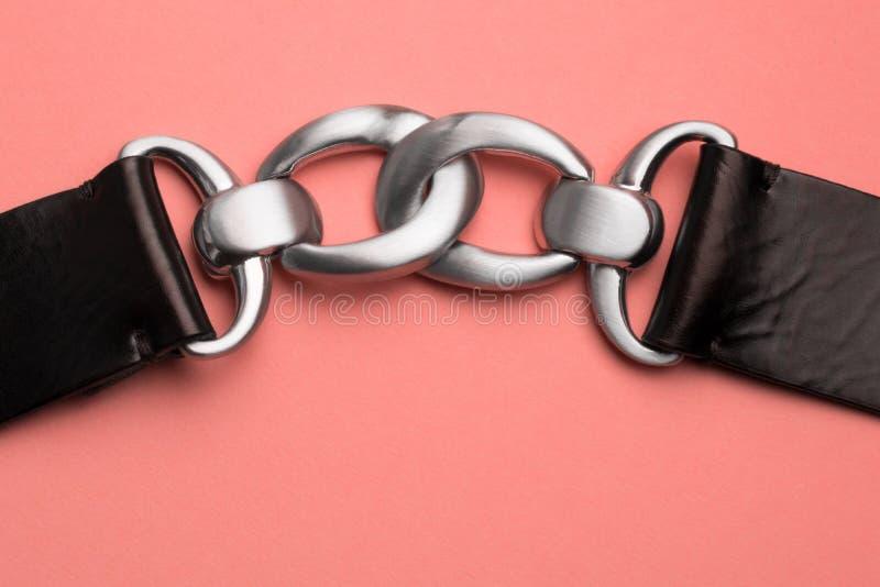 Chain-shaped belt as element of dressing. Stylish fashion stock photography