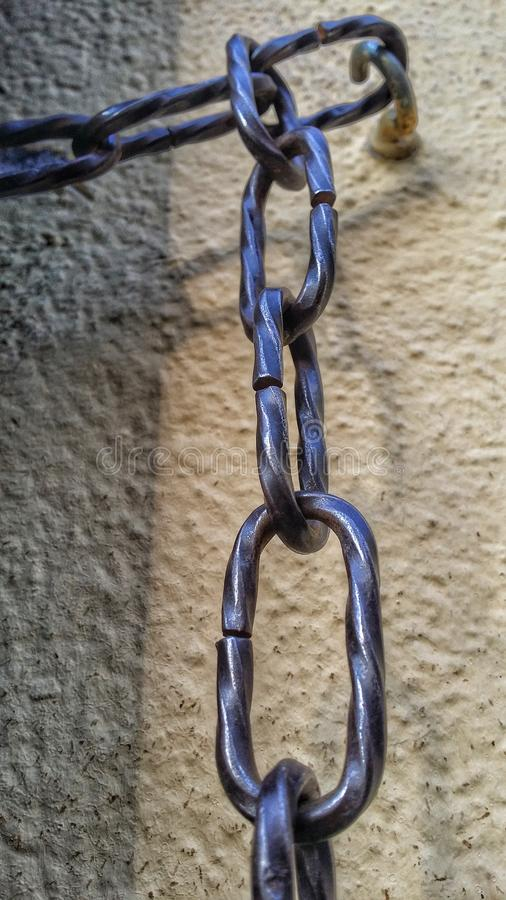 chain on the wall stock image