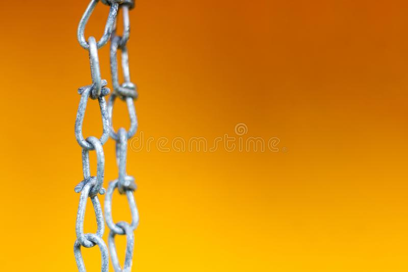Chain on yellow stock photos