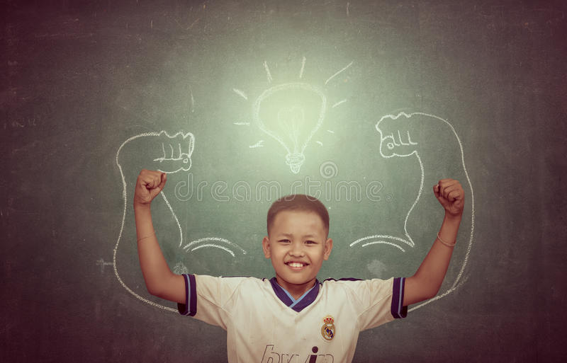 CHAINAT - 22 FEB: Asian strong children against blackboard in cl royalty free stock photography