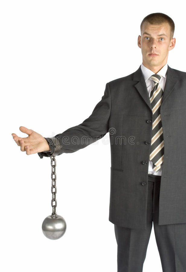 Chained businessman. Businessman with ball and chain stock photography
