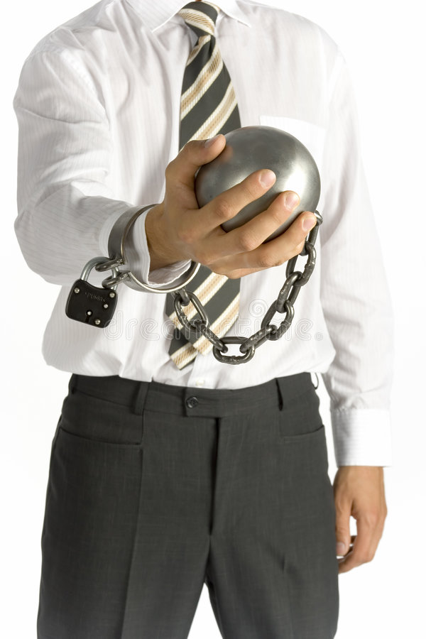 Chained businessman. Businessman with ball and chain royalty free stock photography