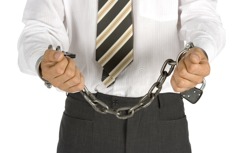 Chained businessman. Businessman with chains on his hands royalty free stock image