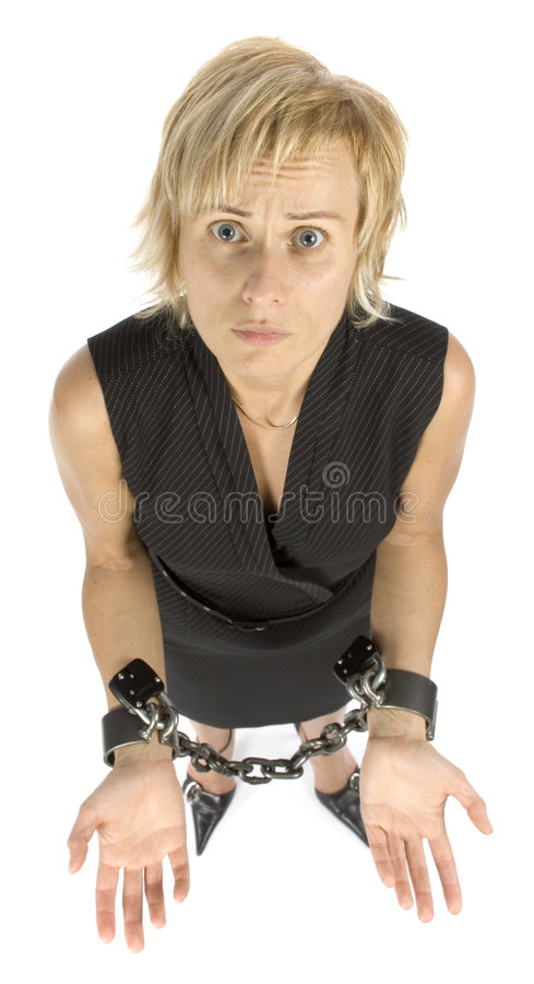 Chained businesswoman. Businesswoman with chains on her hands royalty free stock images