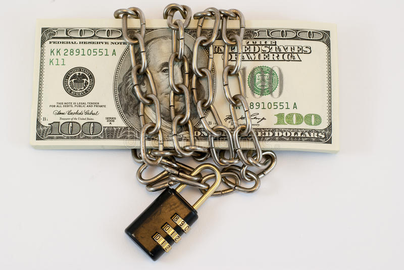 Chained dollars stock photos