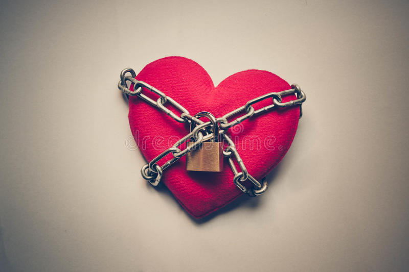 Chained heart. A heart tied with chains and locks stock photos