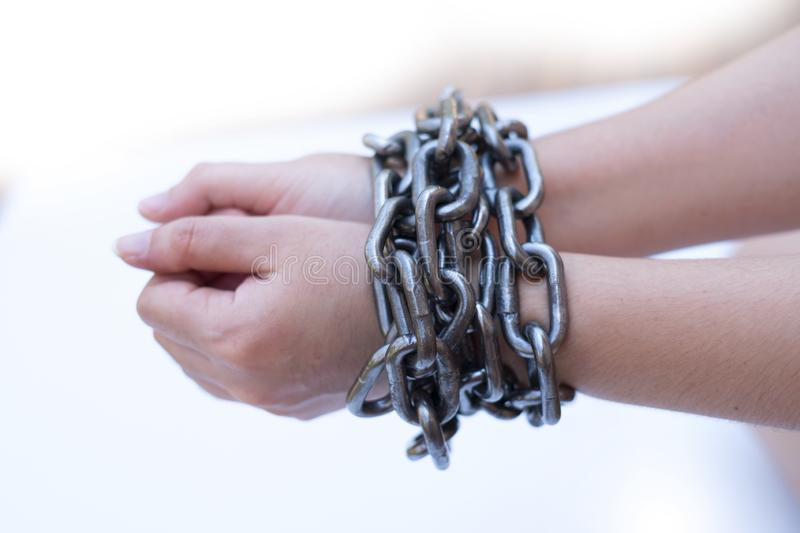 Chained lady hands on white background, Human rights violations concept royalty free stock photography