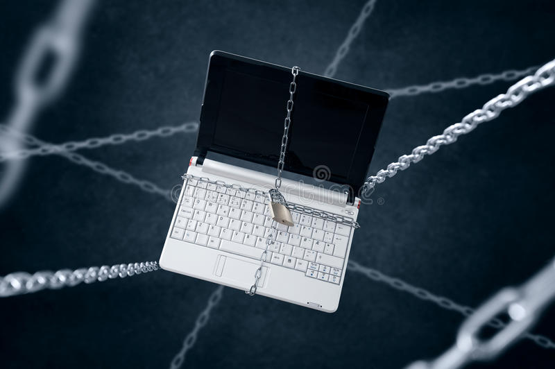 Chained laptop. royalty free stock photography