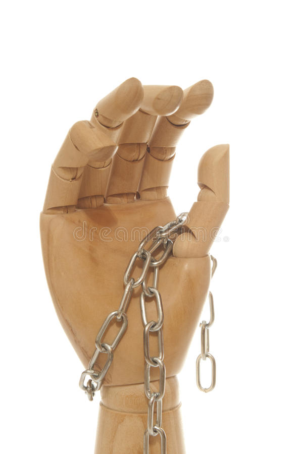 Chained wooden dummy hand stock photography