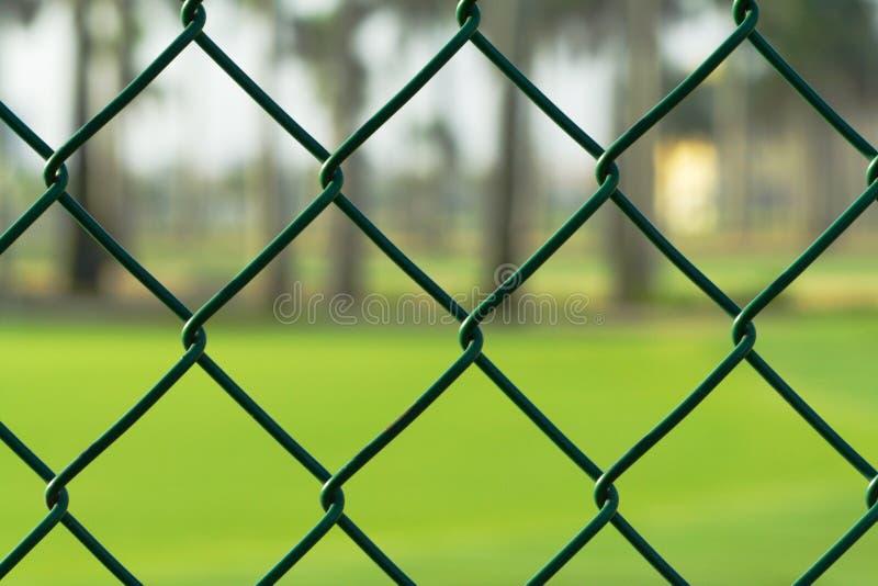 chainlinkstaketgreen arkivfoto