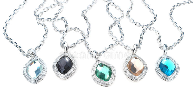Chains with chrystal pendants isolated on white. Set of chains with chrystal pendants isolated on white royalty free stock photography