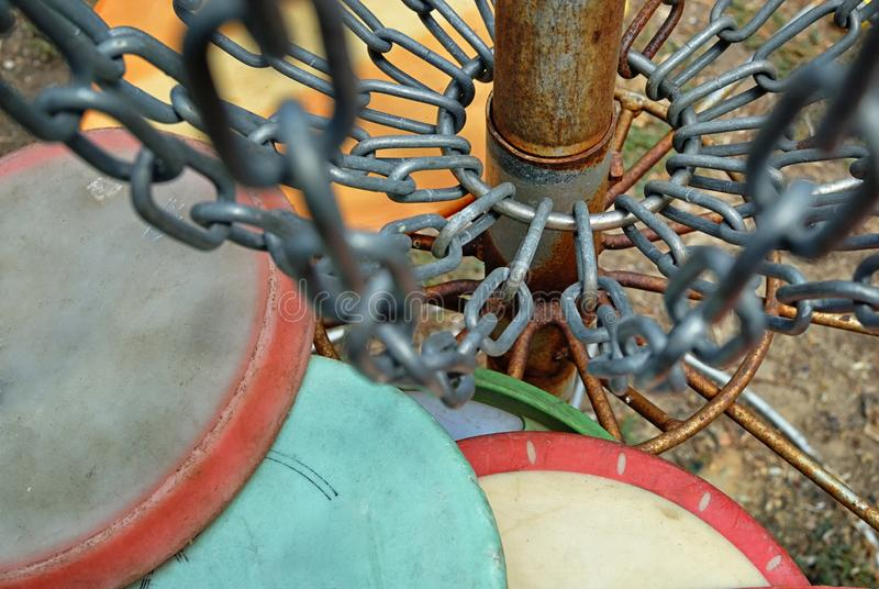Close up of a frisbee golf hole complete with chains and discs. stock images