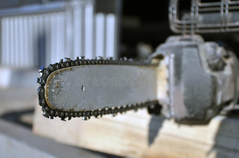 Chainsaw. Close-up of saw chain with residues of sawdust and wood dust stock photos