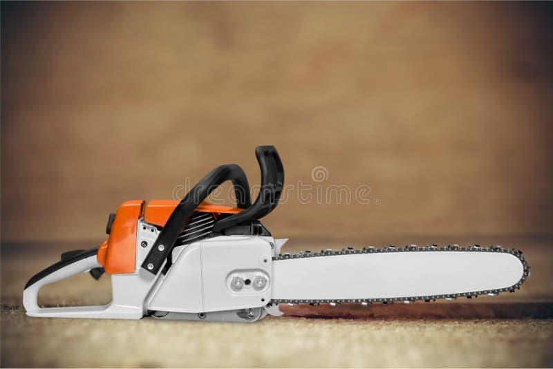 Chainsaw. Gardening Equipment Orange Work Tool Equipment Close To royalty free stock images