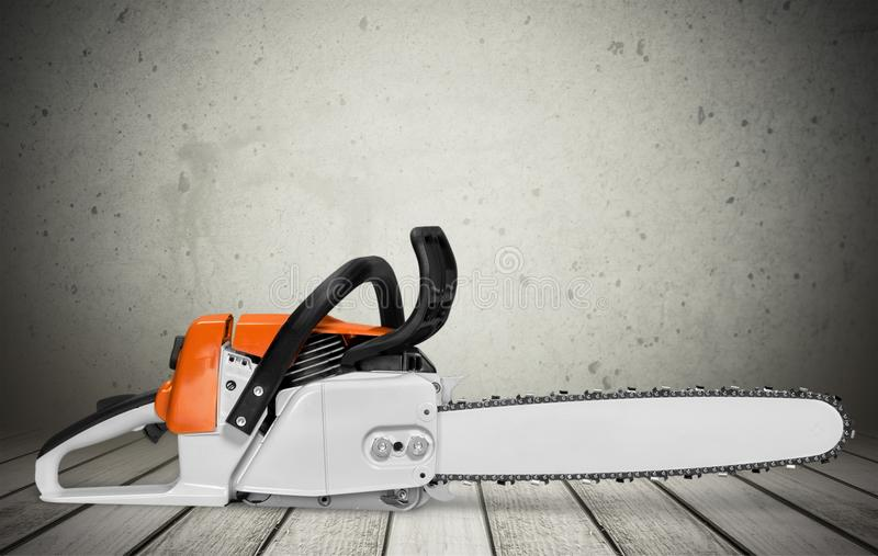 Chainsaw. Gardening Equipment Orange Work Tool Equipment Close To royalty free stock image