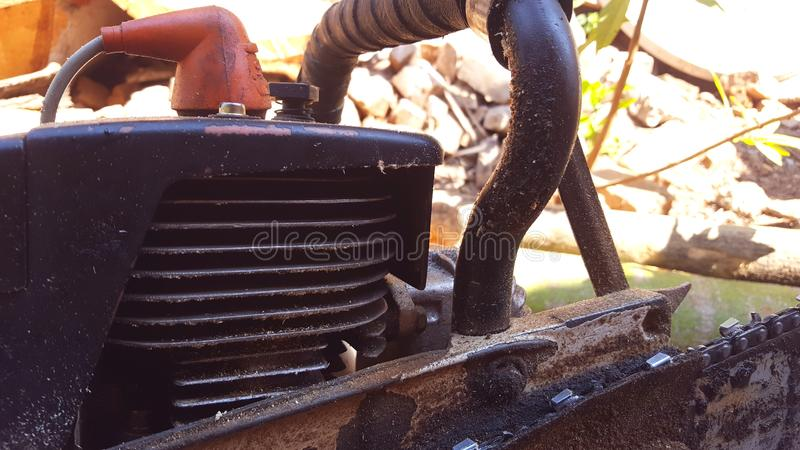 Chainsaw machine parts that are being serviced. Regular maintenance keeps the engine`s performance male and reliable royalty free stock photos