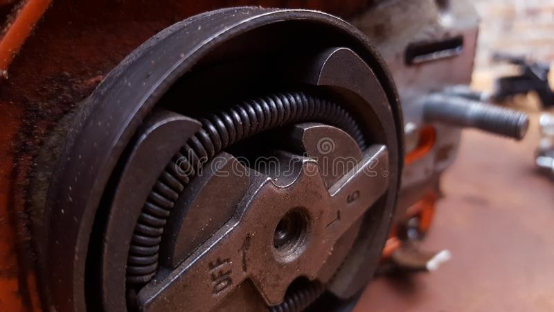 Chainsaw machine parts that are being serviced. Regular maintenance keeps the engine`s performance male and reliable stock images