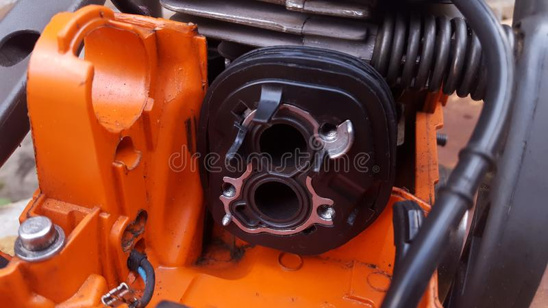 Chainsaw machine parts that are being serviced. Regular maintenance keeps the engine`s performance male and reliable stock photos