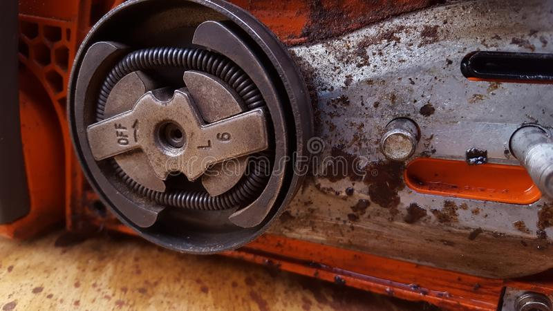 Chainsaw machine parts that are being serviced. Regular maintenance keeps the engine`s performance male and reliable royalty free stock photo