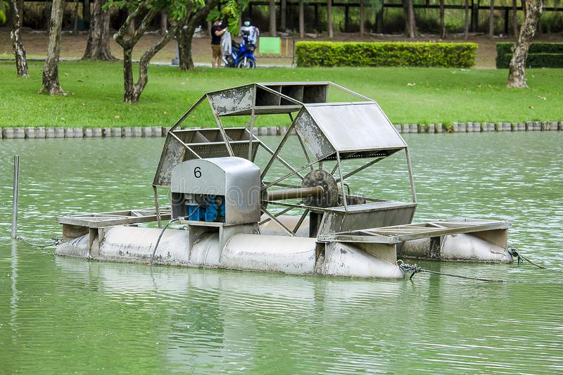 Chaipattana Low Speed Surface Aerator is in the water. Low speed surface Aerator is a water turbine for wastewater treatment by aerating method stock image