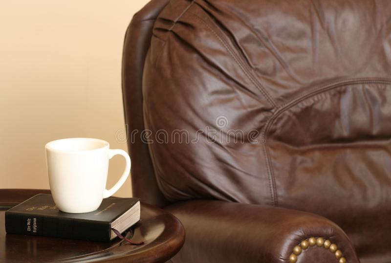 Chair With Bible And Mug Stock Images