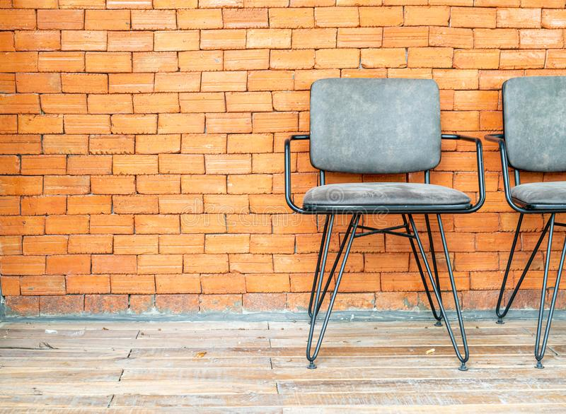 Chair with brick wall. Empty chair with brick wall stock photos