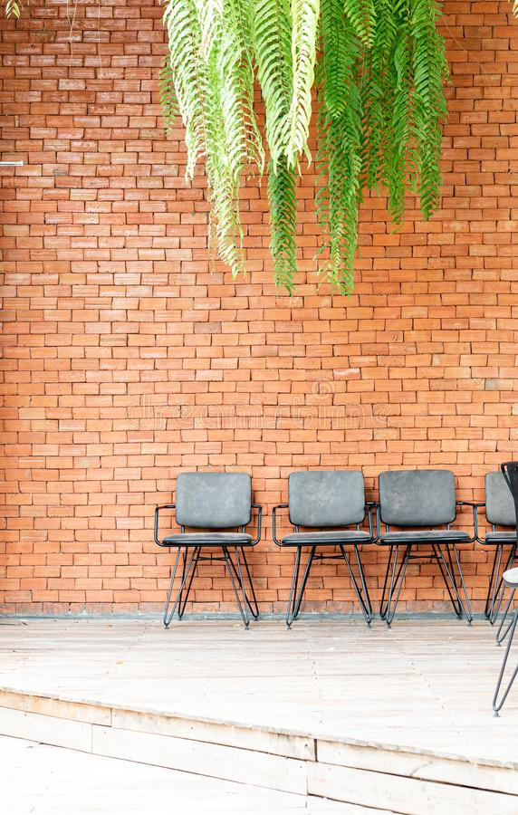 Chair with brick wall. Empty chair with brick wall stock photography