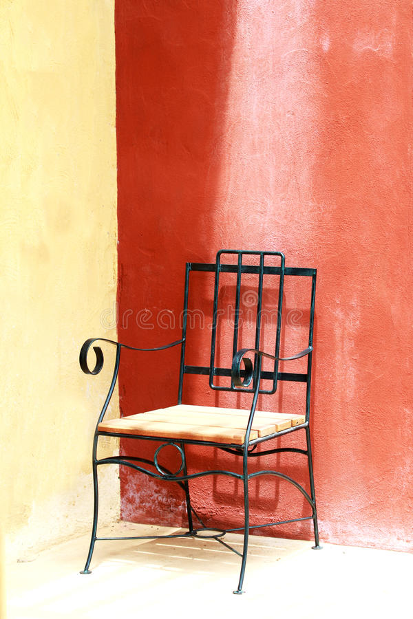 Chair on concrete floor stock photos