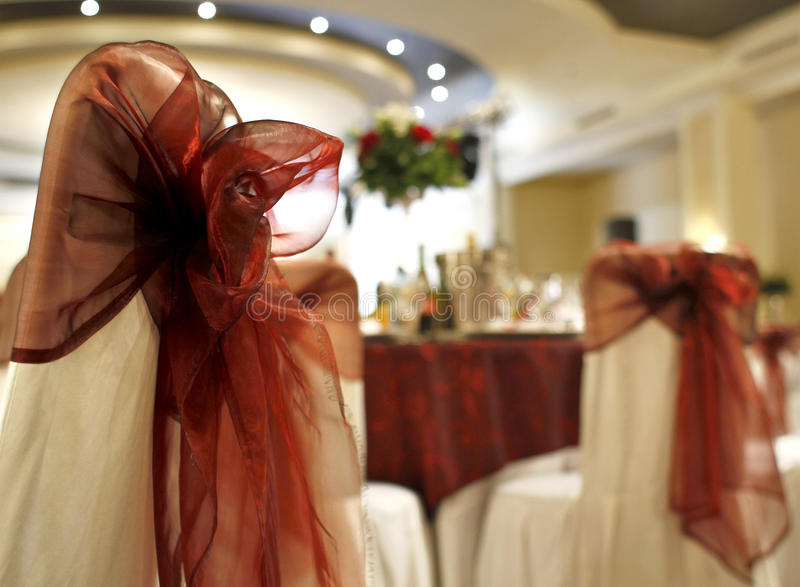 Chair covers. Chairs for a party with chair covers and red ribbon and bows stock photo