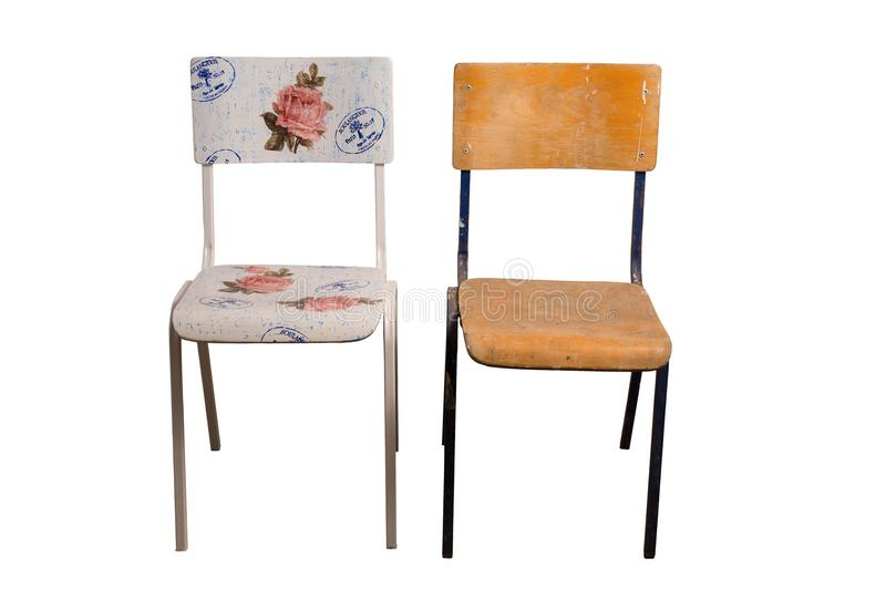 Chair decorated with decoupage technique and an old shabby chair. Old school chair decorated with decoupage technique and classroom chair that is not yet stock photography